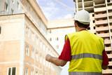 Building Inspector Reviewing Blueprints poster