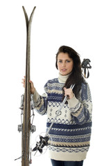 portrait of young woman holding old wooden skis
