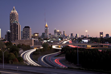 Atlanta skyline just before sunset with traffic streaks