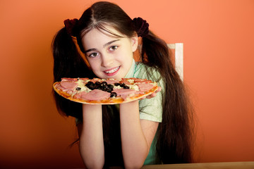 Smiling youn girl with pizza