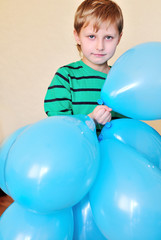 boy holding a lot of balloons