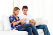 Pessimistic couple stressed with so many bills to pay