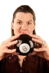 Woman reading the future from a toy eightball