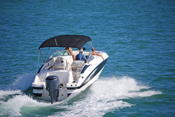 Outboard Motorboat with Blue Canvas Canopy