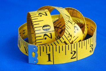 A measuring tape isolated on blue background