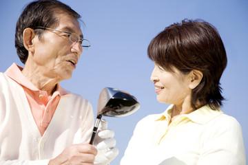 ゴルフクラブと夫婦