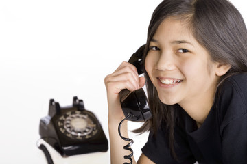 Young girl talking on old fashioned phone
