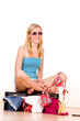 Girl packing summer clothes