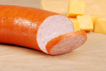 kielbasa with cheddar cheese in background