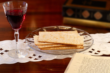 Passover tableau: wine, matzoh, and Hebrew Old Testament