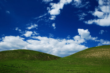 Nature background with clouds and hills