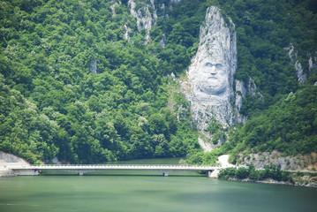human face on mountain rocks
