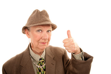 Senior woman in drag giving thumbs up gesture
