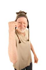 Senior man in knit cap shaking fist