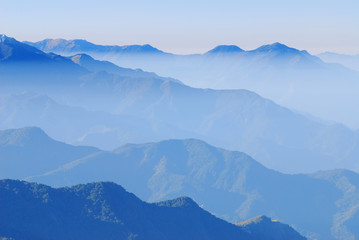 background of mountain crest line with misty cloud.