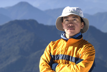 mountaineer portrait with beautiful mountain scenery.