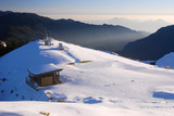 snow scenic with mountain shelter. poster
