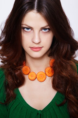 Girl with carrot necklace
