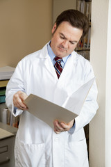 Doctor Reads Patients Chart