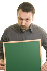 man holding blackboard