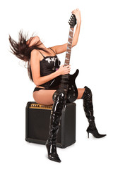 Young attractive sexy girl with rock guitar