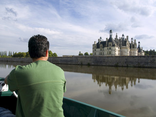 Young man sailing in the canals of Chambord