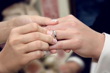 bride giving an engagement ring to her groom