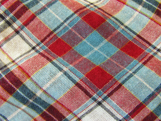A background image of some plaid fabric