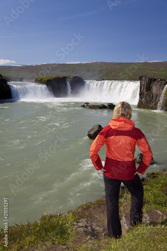 Woman Tourist At Godafoss Waterfall, Iceland