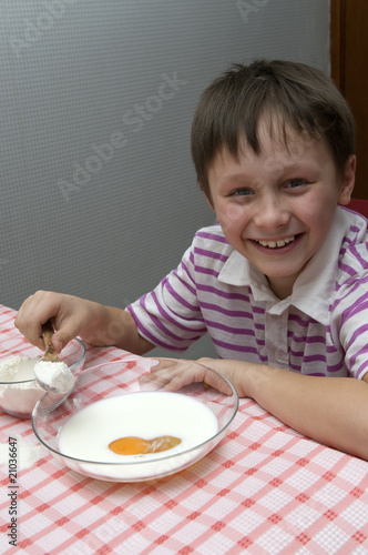 child prepares the dough