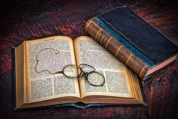 Two old books with glasses