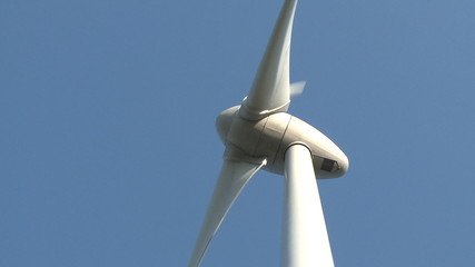 Wind power turbine on blue sky