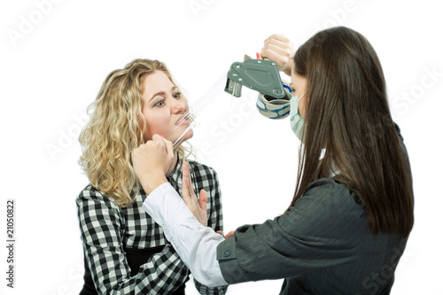 two young caucasian girls playing with scotch tape isolated