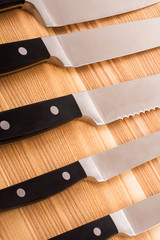 Series. Set of kitchen knifes isolated on wooden background
