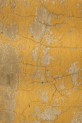 Very worn yellow paint cement texture close-up