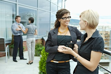 Businesswomen talking outdoor