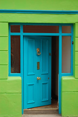 open welcoming blue door