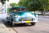 Metallic green oldtimer car in the streets of Havana