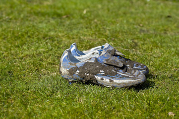 Pair of muddy football boots