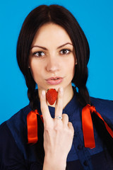 "Young beautiful woman ""smoking"" a strawberry"