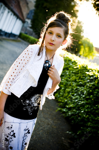 Teenage fashion girl and sun backlight