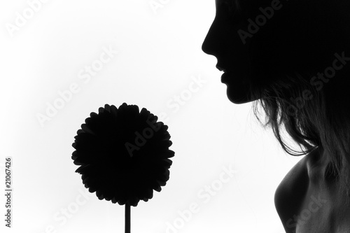 The girl with the big flower on a white background