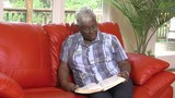 Woman reads bible on sofa - 124