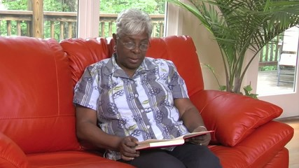 Senior woman reads book - 122