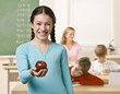 Student holding apple