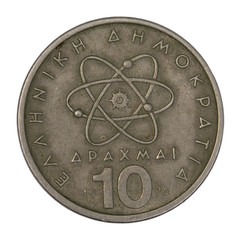 scientific model of atom on old Greek coin