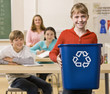Student carrying recycling bin