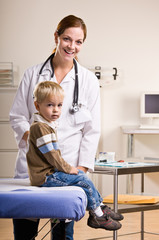 Doctor giving boy checkup in doctor office