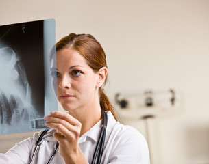 Doctor reviewing x-rays in doctor office