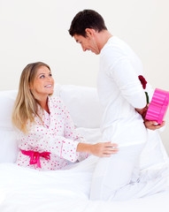 Lovely husband giving a present to his wife
